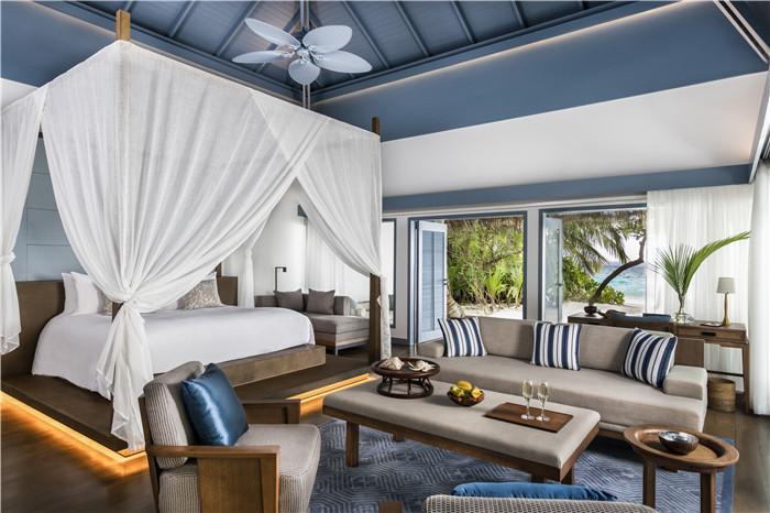 4 - Beach Villa Bedroom ©Raffles Maldives Meradhoo.jpg